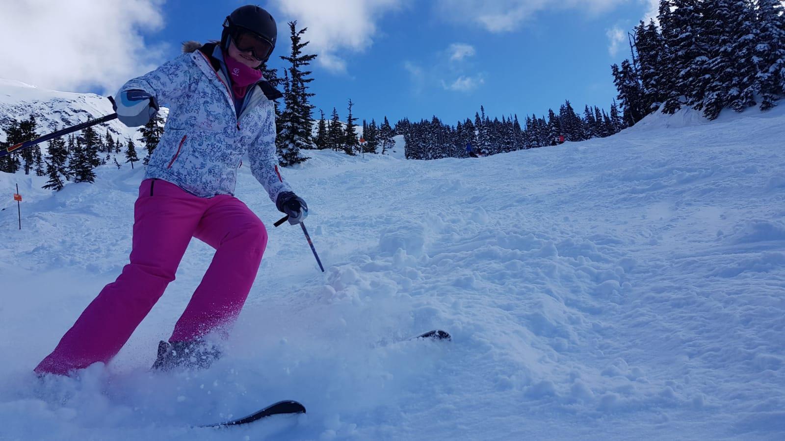 Kathy skiing down the mountainside